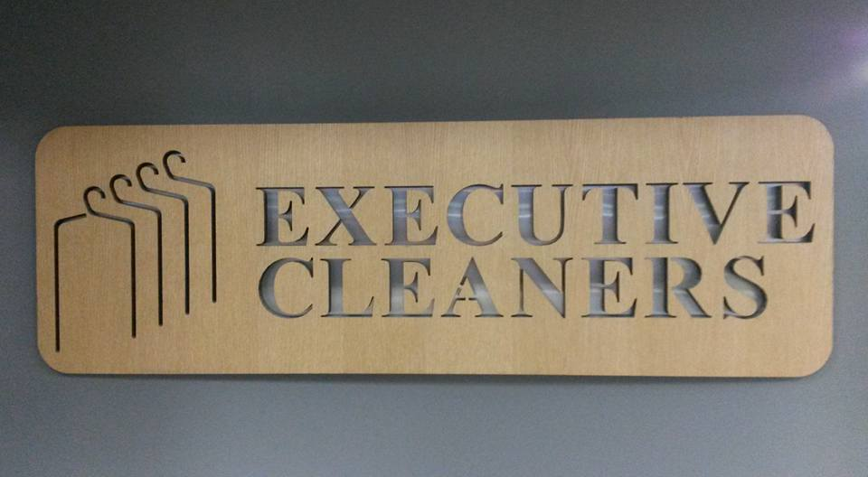 Executive Dry Cleaners logo